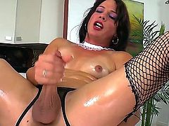 Handsome brunette transvestite chick TS Gina Hart is passionately jerking her big dick until gets cumshot.