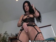 Wild brunette in sexy fishnet likes sitting with her wet cunt over her man's face