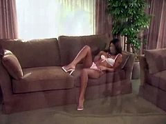 Mouth-watering Indian babe is lying on a couch wearing tempting pink lingerie. She pleases her pussy rolling her eyes with pleasure. White stud joins her on set sticking his tongue to the wet slit. He fingers and eats the girl intensively.