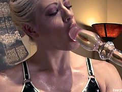 Curvaceous blonde chick takes her latex dress and shakes her ass. After that she toys her ass with big dildo and pussy with a vibrator at the same time.