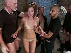 Kinky girl gets bounded and gagged. After that she sucks big dicks and gets fucked hard. She gets her ass and pussy absolutely destroyed.