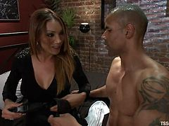 Yasmin Lee sucks on Robert Axel's hard penis. She kisses him and he jacks her dick off. He wants to suck on her tits so he lifts up her shirt and licks her nipples. They get into the 69 position and sucks each other off.