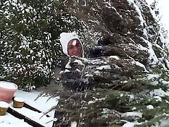 Pretty blonde babe Kathia Nobili with beautiful blue eyes and nice body figure in black warm outfit gets filmed while cleaning snow and having some fun on a winter day.
