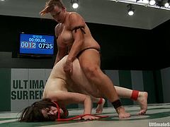 Bella Rossi and Juliette March are having a fight on tatami. They struggle furiously and then Juliette gets her cunt drilled hard by Bella.