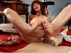 Stunning redhead girl takes her dress off and then gets her feet licked by Johnny Ruiz. Then she gives him an amazing footjob.