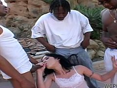 Only the thought of these guy's cocks makes the lovely brunette horny. She knows the guys have some massive dicks and her mouth drools for them. Tiffany is anxious to get gang banged, so she kneels in front of them, to suck their bbc. After tasting of dicks the bitch receives a pounding from behind