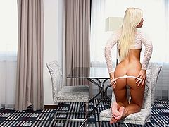 Eye catching blonde hoochie named Lola MyLuv gives stunning performance stripping and playing with her tits. babe gets naked and rubs her delicious cunt with passion.