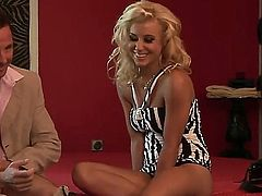 Young blonde slut Nikky Thorne in tight sexy dress and thong gives ehad to tattooed dude and his friend and has rough double penetration with them at photo shoot.