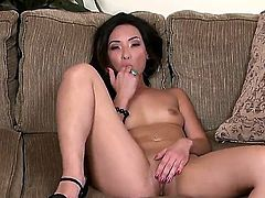 Sex hungry seductress parts her legs to fuck her wet love tunnel with her fingers