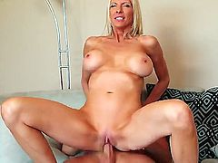 Slender blonde cougar Emma Starr with big tits and long whorish nails gets her shaved minge banged balls deep by young handsome buck Sonny Hicks with long stiff shaft.