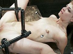 A hot redhead skinny chick gets restrained by bondage machines and then some girl inserts his hand in her cock pocket aka vagina!