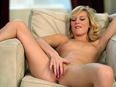 Hypnotizing blonde lassie named Hayden Hawkens exposes her tight pink muff with her legs wide open. She diddles her sweet pussy and fondles it with vibrator.