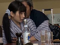 Kinky Japanese girl lies down on a table. Old dude licks and fingers her pussy. Later on she gets fucked hard on the floor.