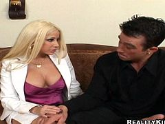 That guy is not only handsome, he also has a huge tool in his pants. That gorgeous and slutty blonde with big tits lets him eat her tits and pussy.