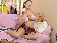 Brunette Lara with small breasts and shaved snatch with soaking wet vagina goes solo