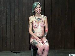 This naughty tattooed girl with dyed hair is going to get some extreme bondage and toying action in this video.