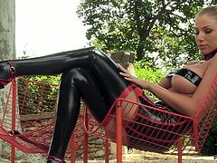 Salacious blonde slave master bitch looks fucking hot in her black latex stockings. She moves her sexy legs from side to side and squeezes her big tits.