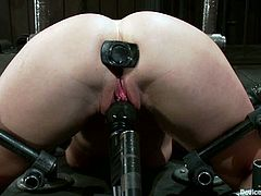Aurora Snow is getting her pussy and asshole toyed, her ass will also be spanked a bit, and all goes on in a BDSM session.