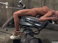 Hot blonde nurse strips her clothes off and gets tied up. She lies on a medical chair getting her pussy and ass toyed by the fucking machine.