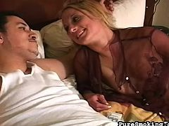 She likes teasing the guy by smoking while sucking his long dick