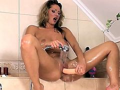 Carolyn Cage has a spectacular body that looks even hotter and sexier when it is all wet and glistening. She also has a nice big toy and she uses it to make her delicate pussy explode.