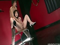 Alluring Japanese milf sits on the chair with legs spread aside while a perverse dude stretches, pokes and rubs her unused pinkish vagina with his fingers.
