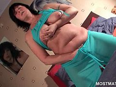 Brunette mature nymph teasing her pussy and big breasts