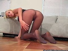 She enjoys teasing by gently posing her pussy through those sexy pantyhose