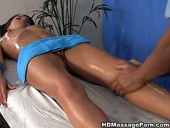 Buff masseur rubs that gorgeous babe's curve with his mighty oily hands. Girl spreads her legs wide open and gets her tight bald pussy finger fucked hard.