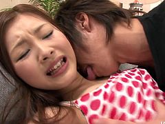Fresh faced Japanese amateur is going through her first sexual experience. A kinky dude hand strokes her small perky tits before he gets to her pinkish bald vagina to give tongue fuck.