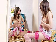 Young beauty likes fingering her pink pussy and enjoy warm pleasure in solo
