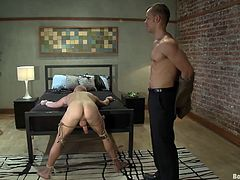 Watch this bondage gay scene where a slave's forced to suck and deep throat her master before he's tied up to the bed and fucked by him.