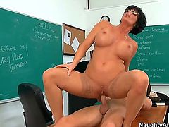 The fact that anyone can enter the classroom and see brunette mommy Shay Fox riding a pulsating pecker is making her nipples even harder and her twat wet.