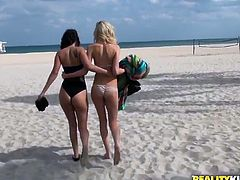 Skinny blonde girl and torrid black haired brickhouse chick show their goodies on cam. One guy offers then to have sex with him for cash and they agree.