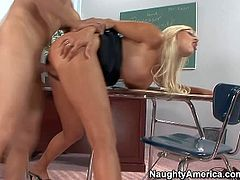 Horny and lusty blonde teacher Puma Swede with glasses gives her hot student a valuable lesson on her knees and pleases him with passionate blowjob session in the classroom