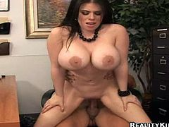 Lewd brunette Daphne Rosen shows her huge boobs to the guy and gives him a hot titjob. Then they fuck in the reverse cowgirl position and Daphne moans loudly with pleasure.