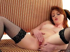 Jaw-dropping hottie in sexy black stockings is aways horny and if there's a chance for a good masturbaton session she takes it. She masturbates her shaved pussy with her fingers and moans with pleasure!
