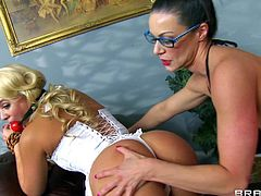 Ball gagged sweet blonde Alexis Monroe gets her big juicy ass and meaty pussy explored by four-eyed milfy lesbian brunette Kendra Lust. She gets her lesbian vagina fingered from behind.