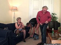 Watch how she was getting dizzy from her young lover's sex ooze, mouthing his fat cock, her hubby showed up.But soon he got strangely turned on and ended up teaming with the stud to fuck the shit of his slutty wife.Don't miss it!