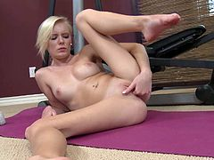Watch Elaina having fun after her daily exercise as she fingers her pink pussy while laying on a mat on the gym floor.