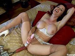 Sexy brunette slut Veronica Avluv is having fun with a fucking machine in a bedroom. She takes her white panties off and gets her coochie amazingly pounded by the sex device.