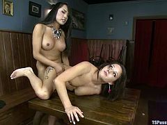 Hot chick gives a blowjob hot shemale. After that she lies down on a table and gets fucked hard right in a bar.
