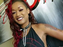 Red-haired ebony chick Skin Diamond shows her tattoos