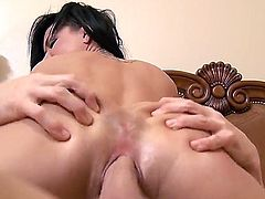 Tattooed black haired curvy bitch Eva Angelina with big fake tits and long red nails gets licked and banged balls deep by randy fucker Johnny Sins with muscled body and long shaft.
