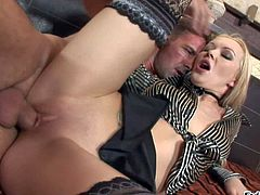 Logan is an elegant white haired babe in sexy black stockings. She gets her shaved snatch fucked deep with her blouse and skirt on. She takes man meat in her anal hole after pussy pounding.