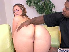 Mariah Kiss has a magnificently-sculpted ass and nice shaved pussy. She pleases her black lover with a nice blowjob and then she bends over to let him control the penetration. He pounds her ruthlessly in and out loosening up her once tight pussy.