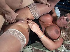 Voluptuous blond mom is wearing white stocking and leather corset. She is devilish sex hunter. So she seduces young stud for hardcore sex. Perverted dude hammers his dick in mommy's pussy from behind. This dude simple destroys her cunt fucking hard. Outrageous porn scene presented by Fame Digital.