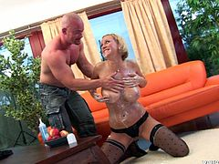 She is a horny and sexy milf. Alice sprays her big tits with whipped cream and licks them off on the couch. She finally gets a man with big tool for her pleasure.