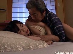 Adorable Japanese girl Arisu Hayase is playing dirty games with an older man in a bedroom. The dude pleases the sweetie with cunnilingus and then smashes her coochie doggy style.