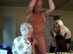This hot blonde milf can't get enough of his stiff cock. She sucks it and her younger sexy friends are helping her out by stroking that lucky guy!